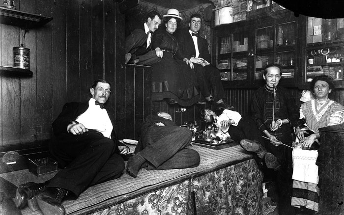 Americans smoke opium in a Chinese-run opium den in New York City in 1925.