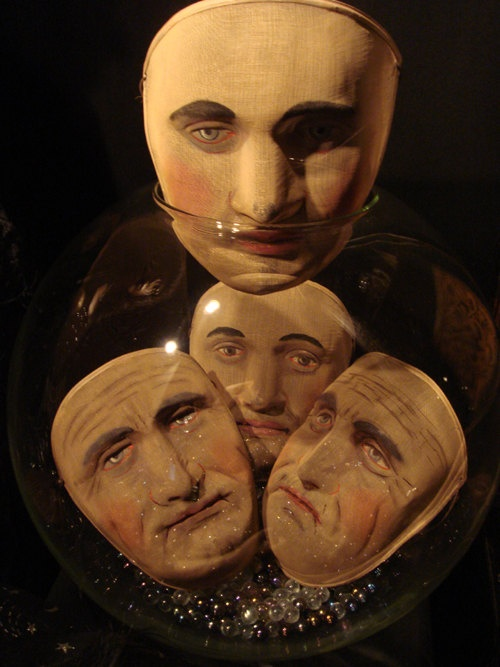 Early 1900s Secret-society masks for the characters of Atum, Mas, Nepthys, and Osiriss offered on Etsy by Gypsy Rose Antiques.