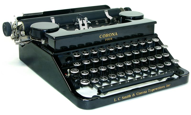 Top: Tom Hanks stood in front of his typewriter collection when he made a video endorsing President Barack Obama in 2008. Above: This is a 1934 flattop Smith Corona similar to the one Chris Hardwick sent Hanks. Via Machines of Loving Grace.
