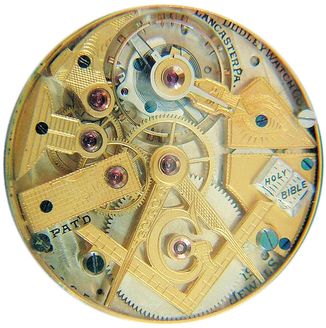 "A watch with movements shaped like Masonic symbols—a slipper, plumb, trowel, level, square, compasses, the Letter ""G"" and a Bible—made by Dudley Watch Company of Lancaster, Pennsylvania, in 1923. Via Phoenixmasonry.org."