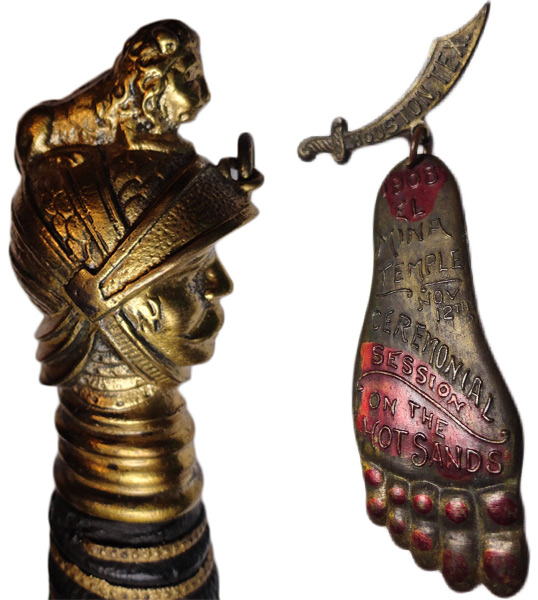 Two items from AR8Jason's collection: At left, the knight-shaped hilt of a Knights of Pythias dress sword. At right, a 1908 foot-shaped pin produced for a Shriners event.