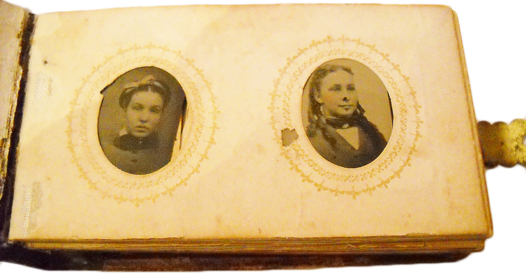 The family in this supposedly haunted 1880s tintype photo album is said to have burned to death in a fire.