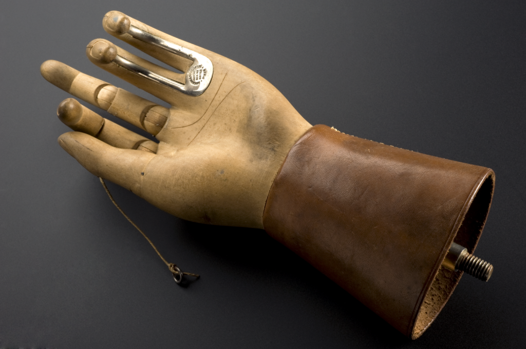 This prosthetic hand was designed by Thomas Openshaw around 1916, while working as a surgeon for Queen Mary's Hospital. The wooden hand has two fingers reinforced with a metal hook to help with daily tasks. Image courtesy the London Science Museum