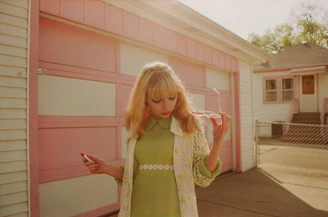 Tavi keeps track of the kitschy spots in her suburban town that look straight out of the past, like this pink and white house. Photo by Petra Collins.