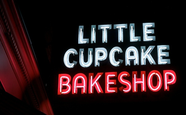 The sign at Little Cupcake Bakeshop, which just moved to a new location in SoHo, is an example of a small business putting up a new neon sign. Photo by Hively.