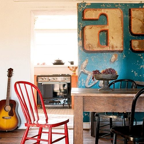 In 2008, hip design blog Apartment Therapy found inspiration in using a giant beat-up vintage sign as a rolling door. Credit: Marie Claire Maison via the style files.