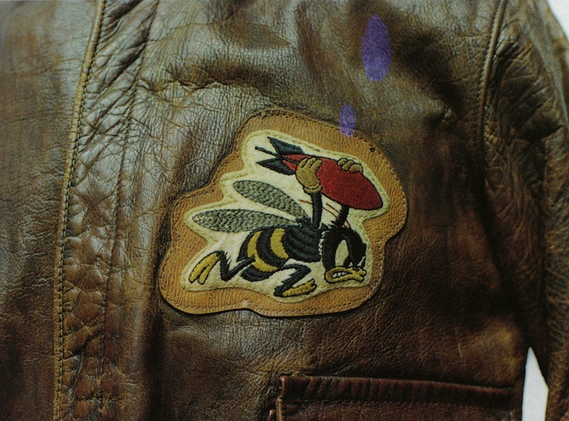 """Wee Willie,"" a bee carrying a red bomb, was the insignia of the 21st Bomb Squadron, 30th Bomb Group. The patch is sewn to the A-2 of Captain Earnest C. Pruett, who flew B-24 Liberators."