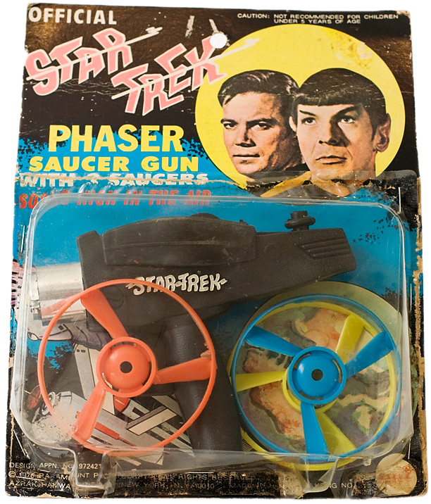 "This AHI ""Official Star Trek Phaser Saucer Gun"" combines the TV show's recognizable weapon with a common style rack toy. Image via startrek.com."