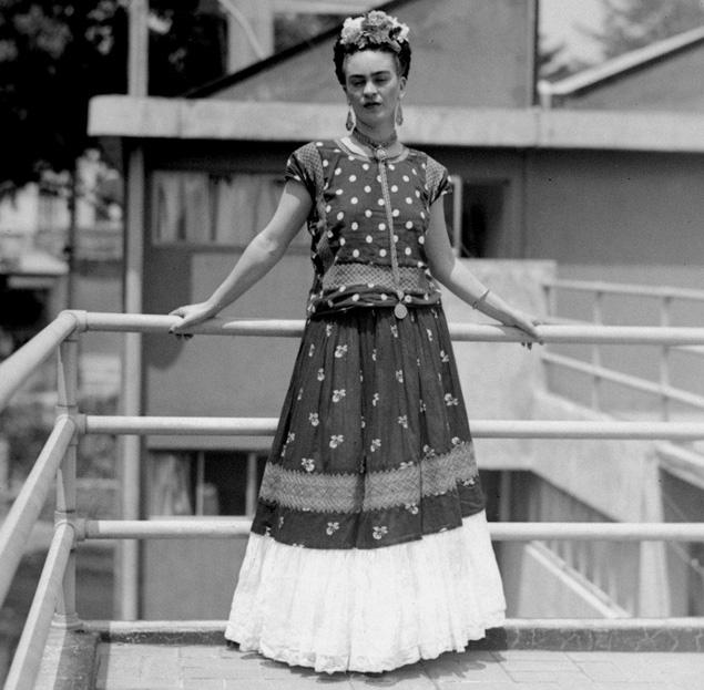 Top: Frida Kahlo wearing a signature colorful look. Photo by Nickolas Murray. Above: Frida displays the three elements of Tehuana dress—the floral headpiece, square-cut blouse, and long skirt.