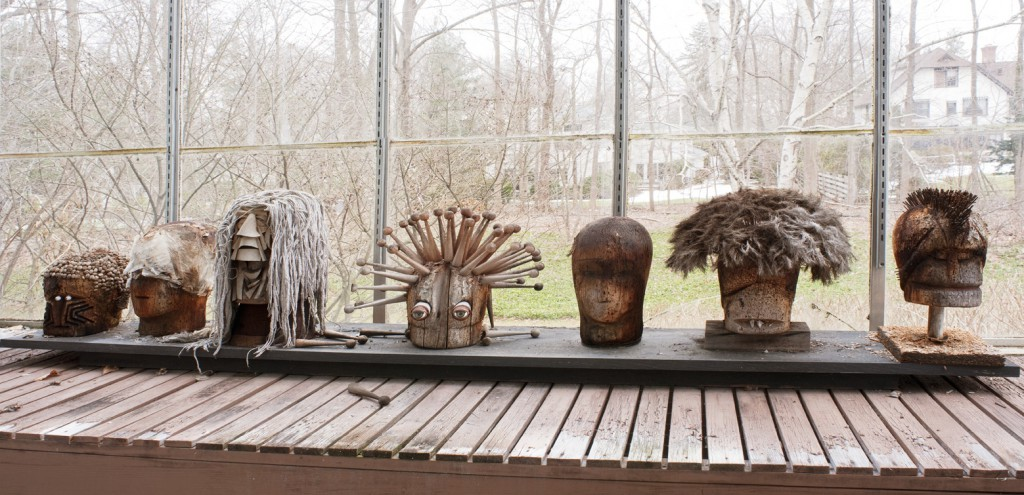"These busts in Harper's home are made from hat forms, construction paper, beads, shells, doll eyes, clock parts, tree branches, and even a mop head. Photo by D. James Dee, from ""Irving Harper Works in Paper."""
