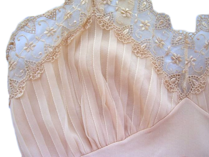 A closeup of the bodice of a beige vintage Val Mode slip with pintucked accordion pleats. Via aslipofagirl.net.