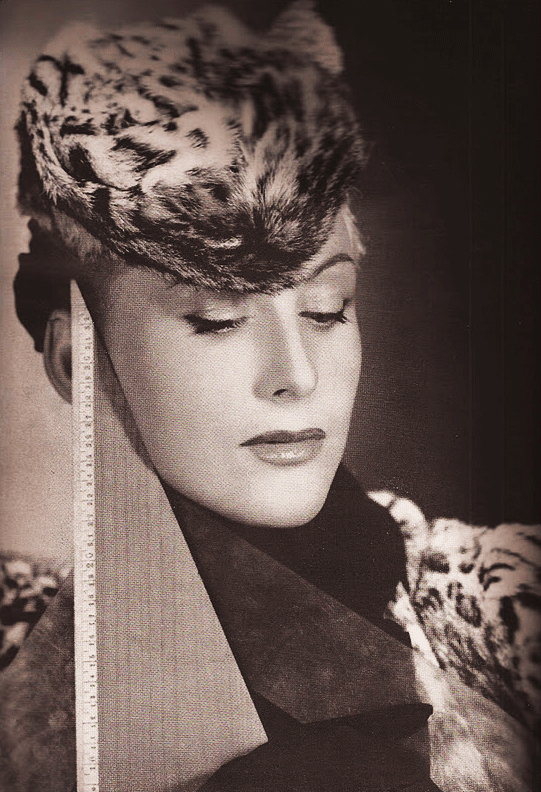 Elsa Schiaparelli's hat made from a leopard's face was featured in the September 1939 issue of Bazaar. (Via DevorahMacdonald.blogspot.com)