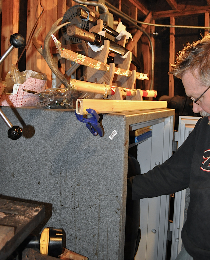 Above: Boyd reaching into one of the safes in his fortified workshop. Some repair jobs sit on top of the safe. Top: Boyd's favorite sword is similar to one that made an impression on him in the basement of The Met at the age of 17.