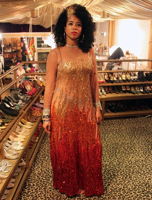 "R&B singer Kelis tries on a 1970s dress Nolan Miller created for Gladys Knight. Via the ""L.A. Frock Stars"" Facebook page."