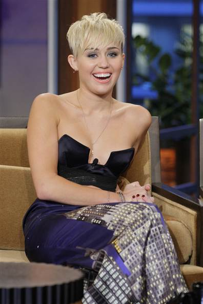 "In October, Miley Cyrus wore a vintage Moschino skirt from the 1990s from The Way We Wore on ""The Tonight Show with Jay Leno."" Via NBC.com."