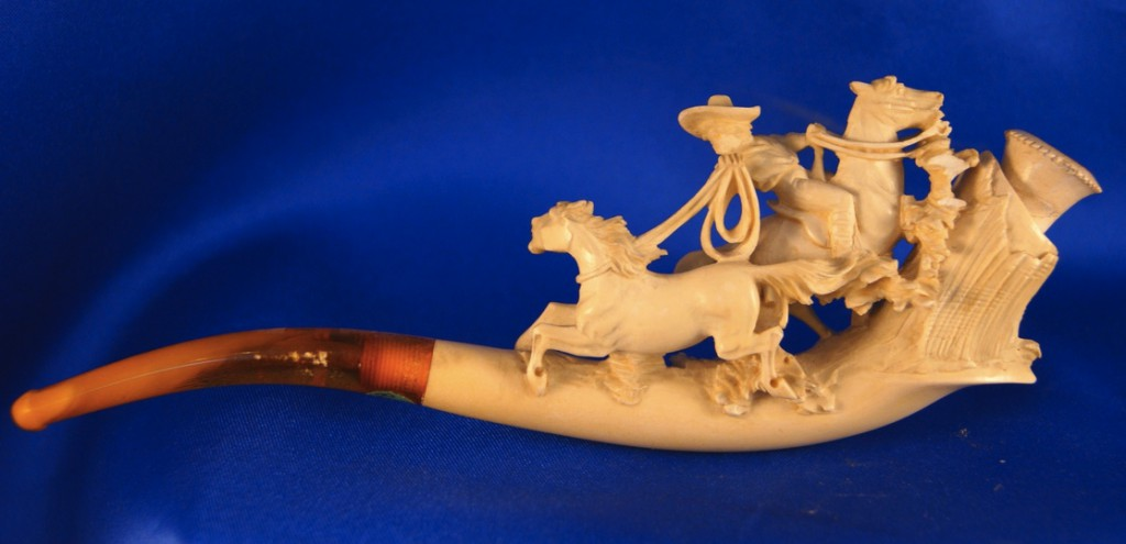 Carvings of men on horseback roping animals (in this case, a colt) are not uncommon on cheroot holders.