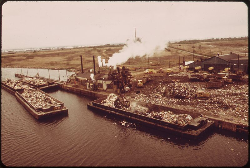 Nagle believes a better connection to our garbage's afterlife might help curb our monstrous waste.  Above, barges transport waste to Fresh Kills in 1973.