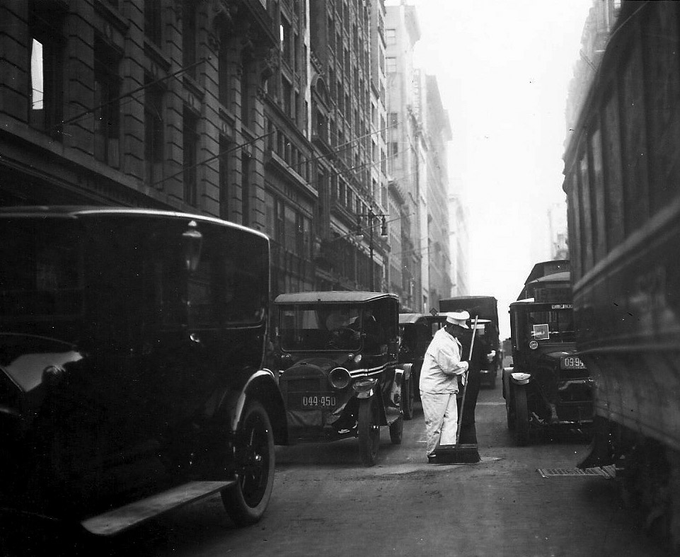 Street traffic has long been a serious danger to sanitation workers, as seen in this image from 1907.