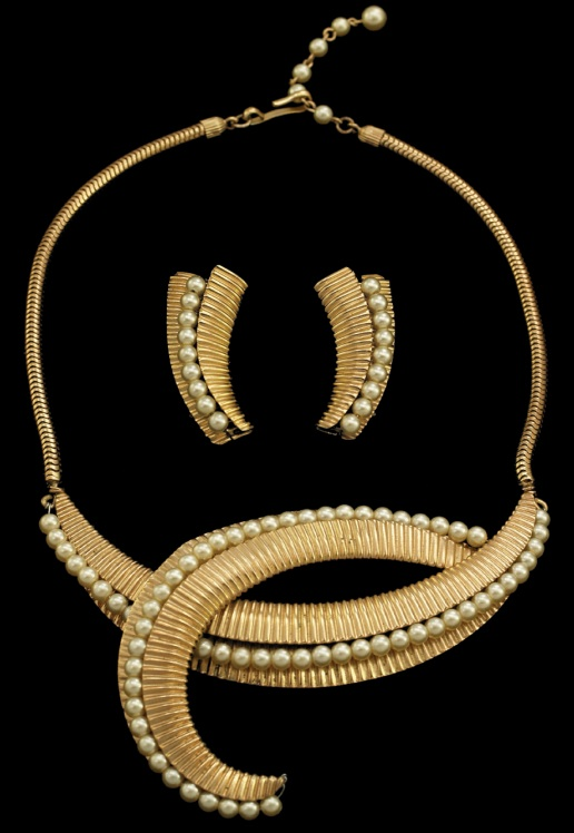 "An early 1950s Napier demi-parure with necklace, earrings, and bracelet (not shown) features fluted gold-plated brass lined with faux pearls. (From ""The Napier Co."")"