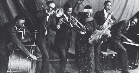 Ma Rainey, pictured in 1925, and other blues divas of the era usually performed with a backing band. (Via NotesOnTheRoad.com)
