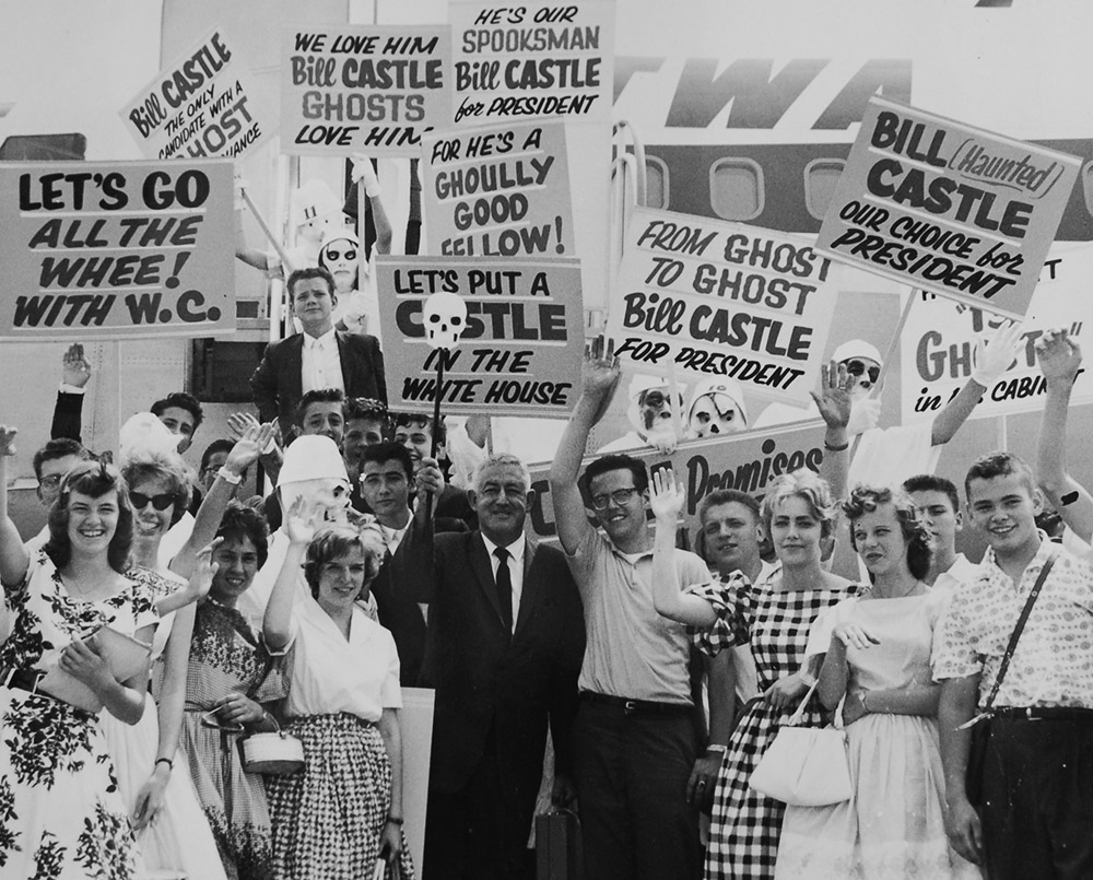 William Castle, center, promotes his films with some of his teenage fans.