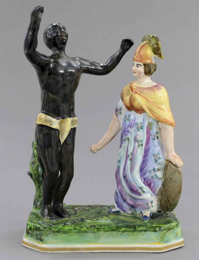 A figure commemorating the end of slavery in Britain and its colonies shows a black man celebrating, free of bondage, with Brittania happily observing. Photo © Myrna Schkolne 2013