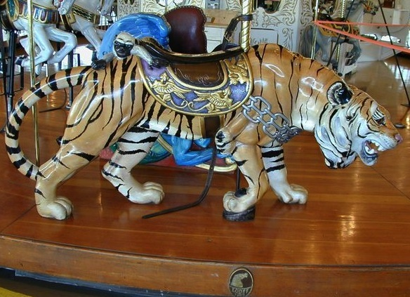 Sneaky the Tiger, part of the 1909 Looff carousel in Spokane, is one of only three carousel tigers carved stalking. Pam Hessey restored the other two of these Looff tigers, which are worth around $80,000, for private collectors. (© Gary Nance, via carousel.org)