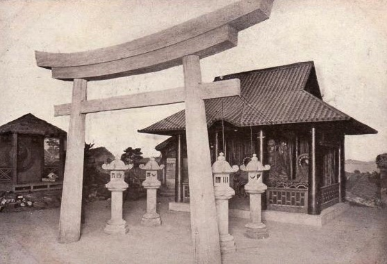 "This souvenir postcard depicts a Buddhist temple, temple lanterns, and torii at the Japan Scene in ""The World in Boston."""
