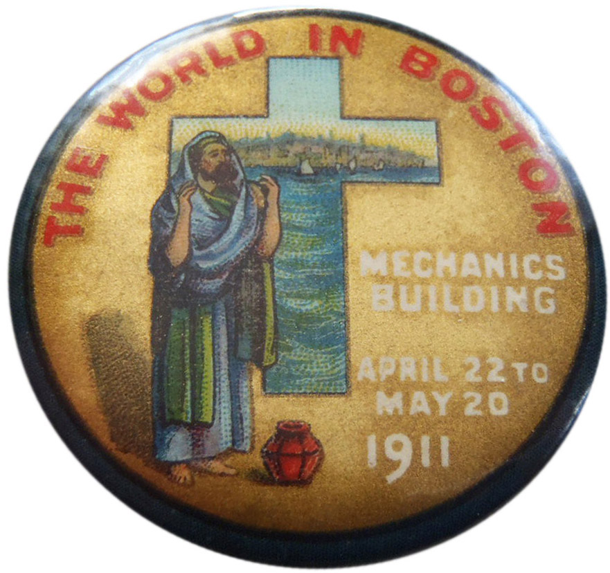 "A souvenir pinback advertises ""The World in Boston,"" held at Boston's Mechanics Building from April 22 to May 20, 1911."