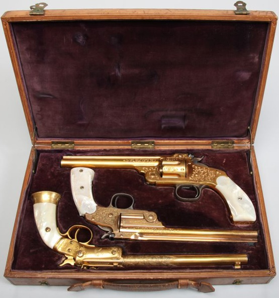 Three of Annie Oakley's guns, gold-plated cased presentation pistols, manufactured by Smith & Wesson and J. Stevens Arms & Tool Company, circa 1891. (From the Autry National Center)