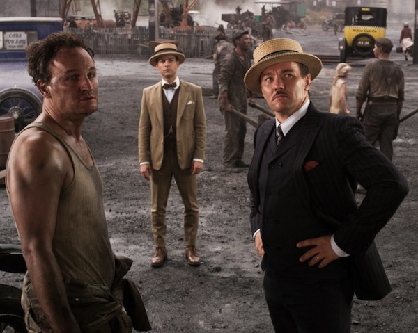 "For men, the 1920s meant straw boater hats, saddle shoes, and three-piece suits. But pants definitely would have been wider than the ones Tobey Maguire (center) sports as Nick Carraway in ""Great Gatsby."" (Courtesy of Warner Bros.)"
