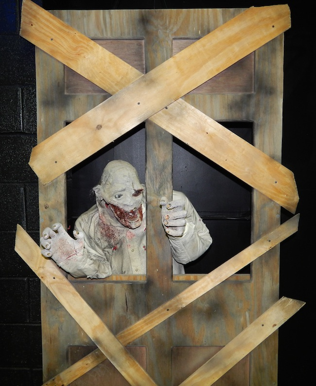 A ghoul that pops up inside a boarded door is one of the new Scare Factory stunts installed after 2012's Superstorm Sandy hit Spook-A-Rama at Deno's Wonder Wheel Park in Coney Island, New York. (Courtesy of LaffintheDark.com)