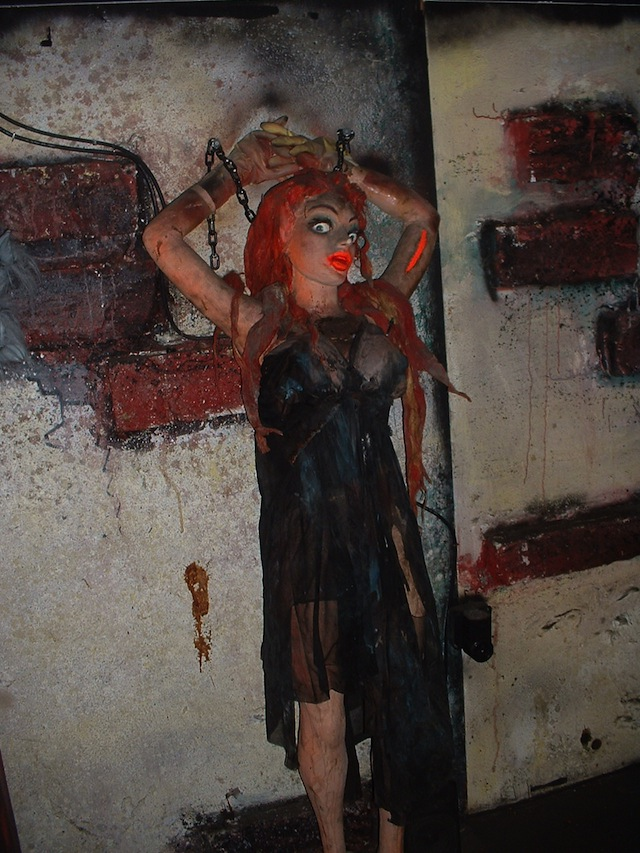 "This typical Bill Tracy maiden-in-distress at the torture-chamber scene in the Haunted House ride at Ocean City, Maryland, contains air cylinders that give her a ""heaving bosom."" (Courtesy of LaffintheDark.com)"