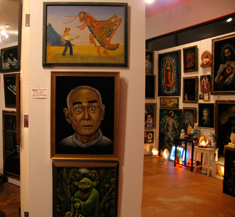 A giant cricket, Heaven's Gate cult leader Marshall Applewhite, and Yoda hung near a room of religious art in Portland's Velveteria. (Via Velveteria.com)
