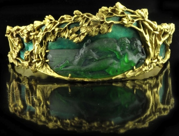 This 1900 Art Nouveau bracelet by René Lalique shows a mythic seduction scene in glass, enamel, and yellow gold. (The Hairpin, via Hancocks London)