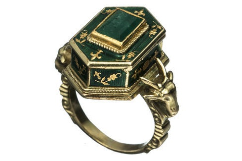 This enamel, gold, and emerald poison ring from the Victorian Era also features ram's heads, an occult symbol. (The Hairpin, via AlexisBittar.com)