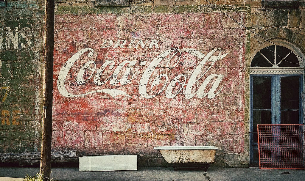 Artisanal advertising reviving the tradition of hand painted signs the familiar coca cola logo seen here on a hand painted ghost sign malvernweather Image collections