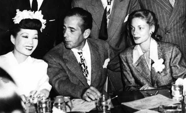 All the big Hollywood stars visited Chinatown nightclubs in their heyday. Here, Jadin Wong chats with Humphrey Bogart and Lauren Bacall.