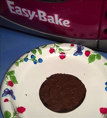 An Easy-Bake hockey-puck-shaped chocolate cake. (Posted by looneytunesfan on Food.com)