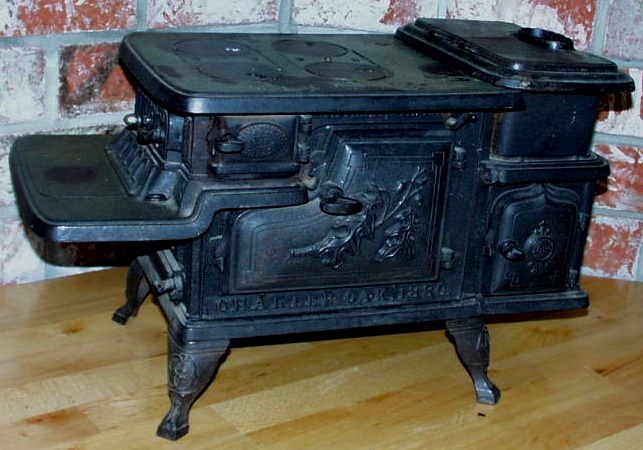 This cast-iron Charter Oak child-size stove, which measures about 24 inches across, could have been a toy or a store display. (Via Antiqbuyer.com)
