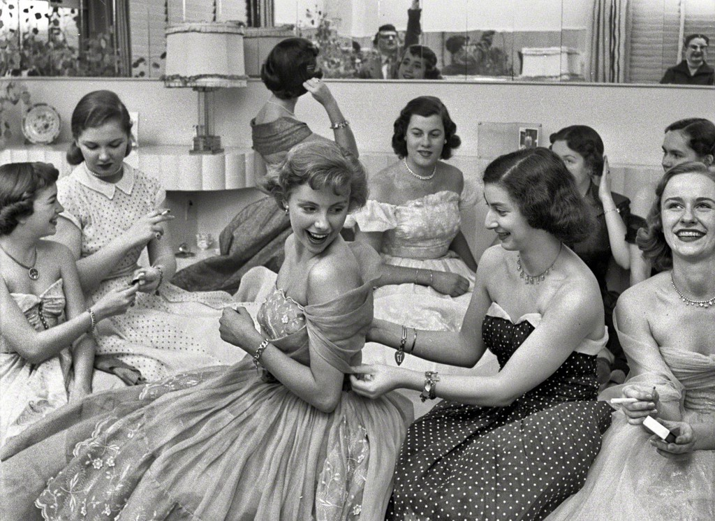 "Socialite Betsy von Furstenberg and friends get ready for a party in the ""Look"" magazine article ""The Debutante Who Went to Work,"" from 1950. When the strapless dress first became popular, its structural foundation was much stronger compared to modern dresses of stretch fabric. Via shorpy.com."
