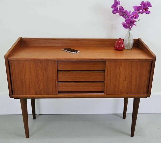 This 1960s Danish Modern teak desk and the modern-day iPhone embody Stephen Bayley's ideals of beautiful design.