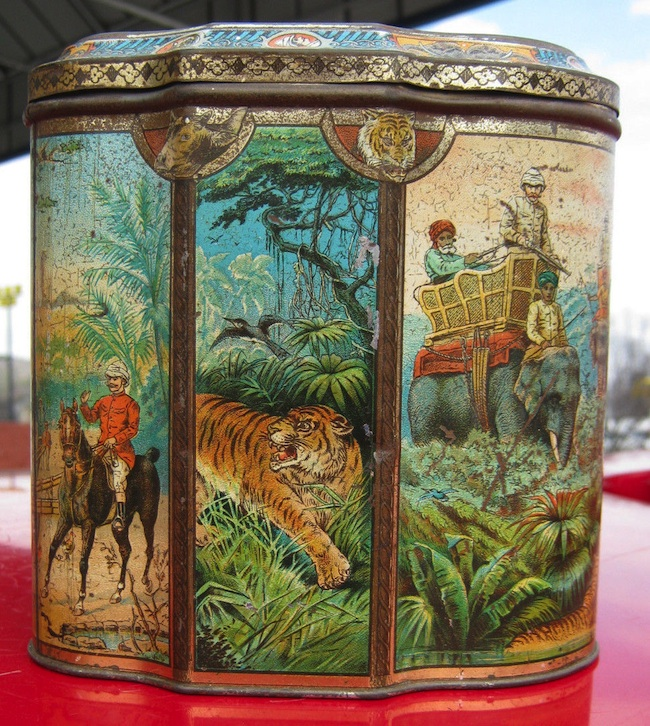 This Huntley and Palmers Indian Elephant biscuit tin, circa 1894, features a unique shape and elaborate color lithography.