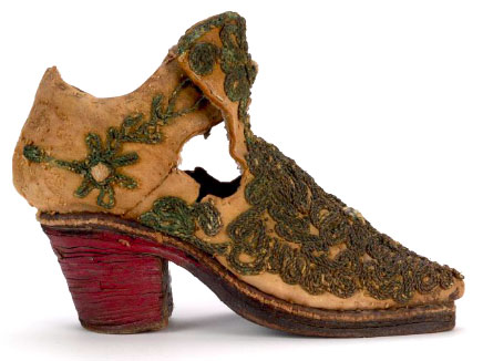 By the late 17th century, men's footwear incorporated heels drawn from Persian riding boots, like this boy's boot with a stacked leather heel. Courtesy the Bata Shoe Museum.