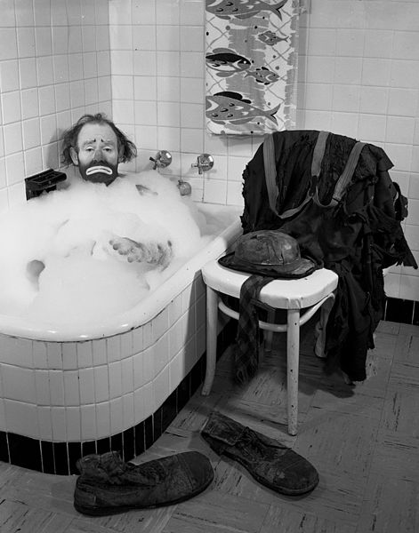 Ringling Circus clown Emmett Kelly, Sr., in a bubble bath in Sarasota, Florida, circa 1955. He posed for this photo for his Christmas card. (Via State Library and Archives of Florida)