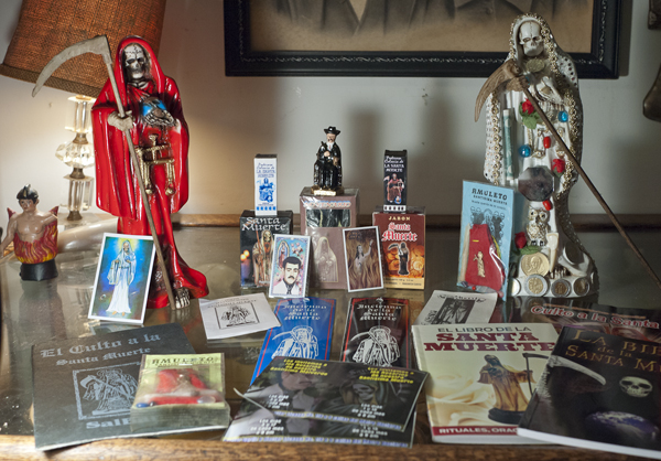 Joanna Ebenstein's collection of Santa Muerte artifacts. (Via Morbid Anatomy)