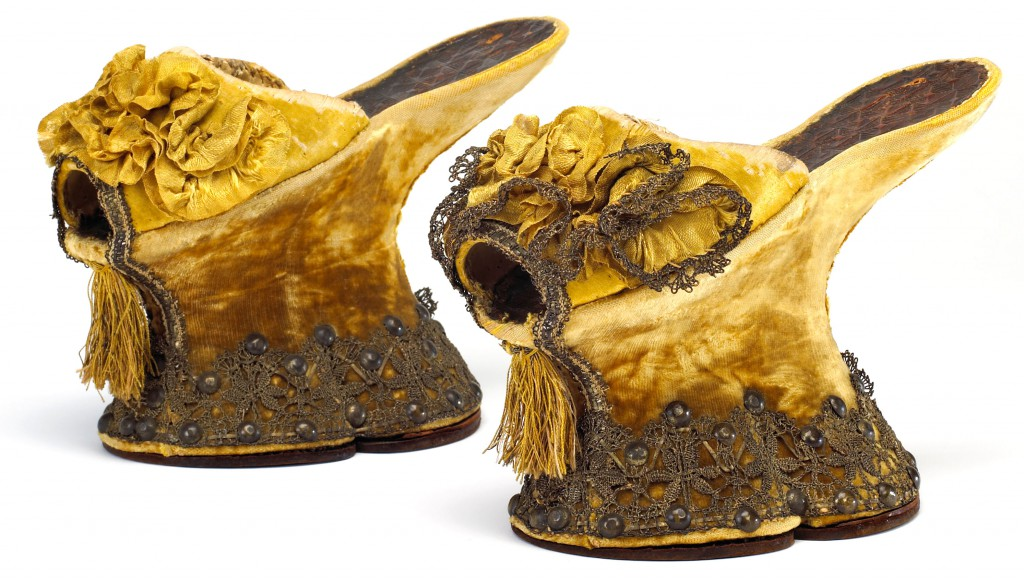 In the 16th century, upper-class Venetian women would have worn elegant chopines like this pair of velvet-covered shoes, which were explicitly designed as luxurious fashion (circa 1580-1620). Courtesy the Bata Shoe Museum.