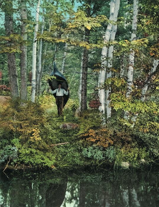 An Adirondack outdoorsman carrying his canoe.
