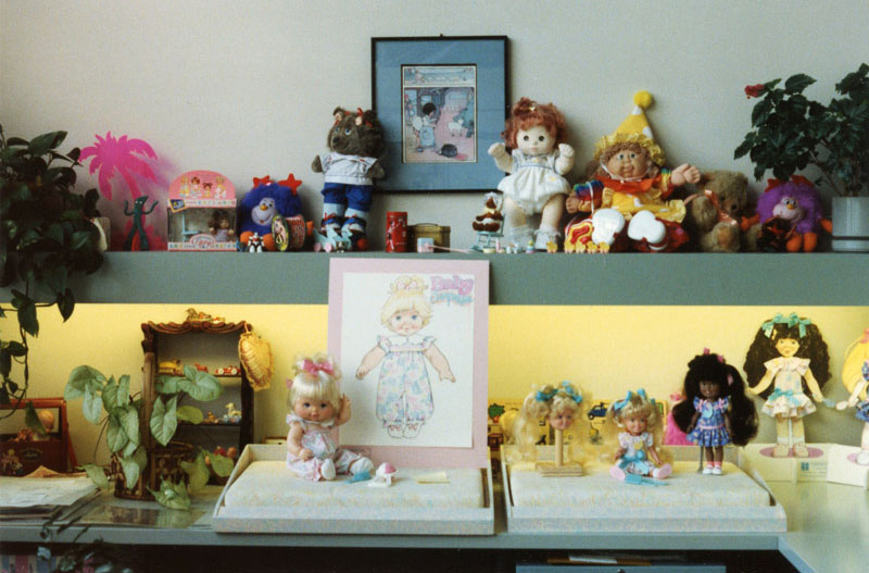 On Eskander's desk at Hasbro in the late 1980s, the top shelf showcased toys in her collection, while the dolls below were projects she was working on.