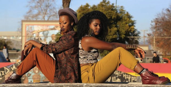Dominique and Jazmyne Drakeford pose at a park in Oakland, California. The sisters are masters of thrift-store fashion. (Photo by Pendarvis Harshaw)
